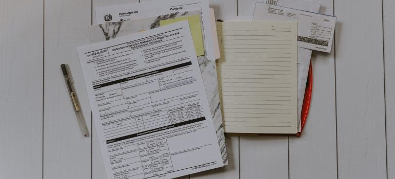 a bunch of documents on a table