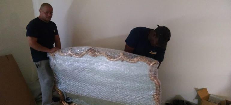 movers packing an item